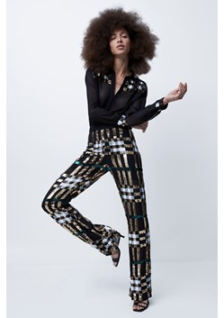 Bala Embellished Check Flared Trousers