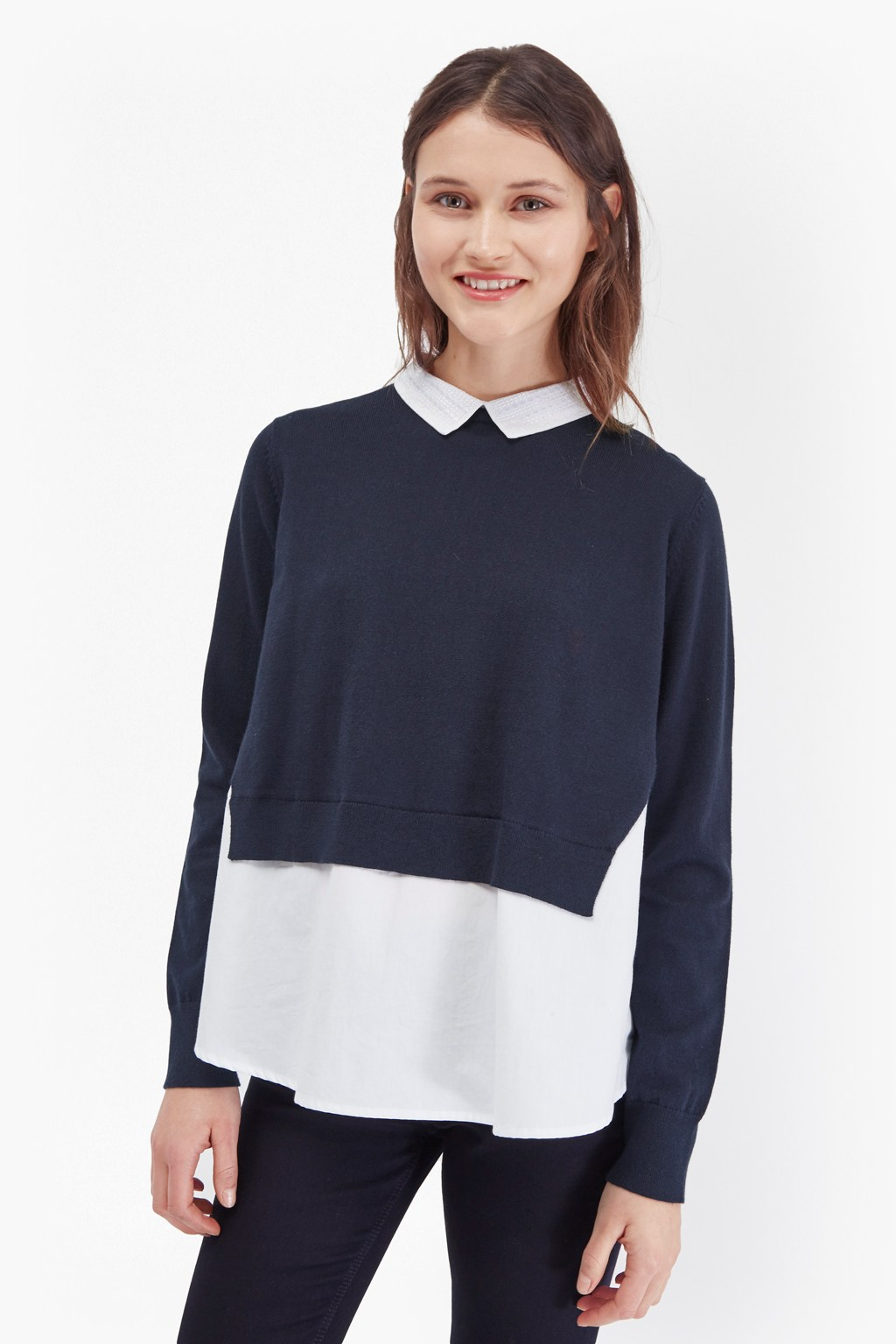 Alternatively, you can wear it like a classic jumper: layered over the top of your shirt and/or tie and then buttoned up all the way or with a couple left undone.