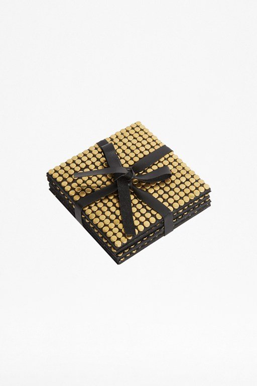 set of 4 gold studded coasters