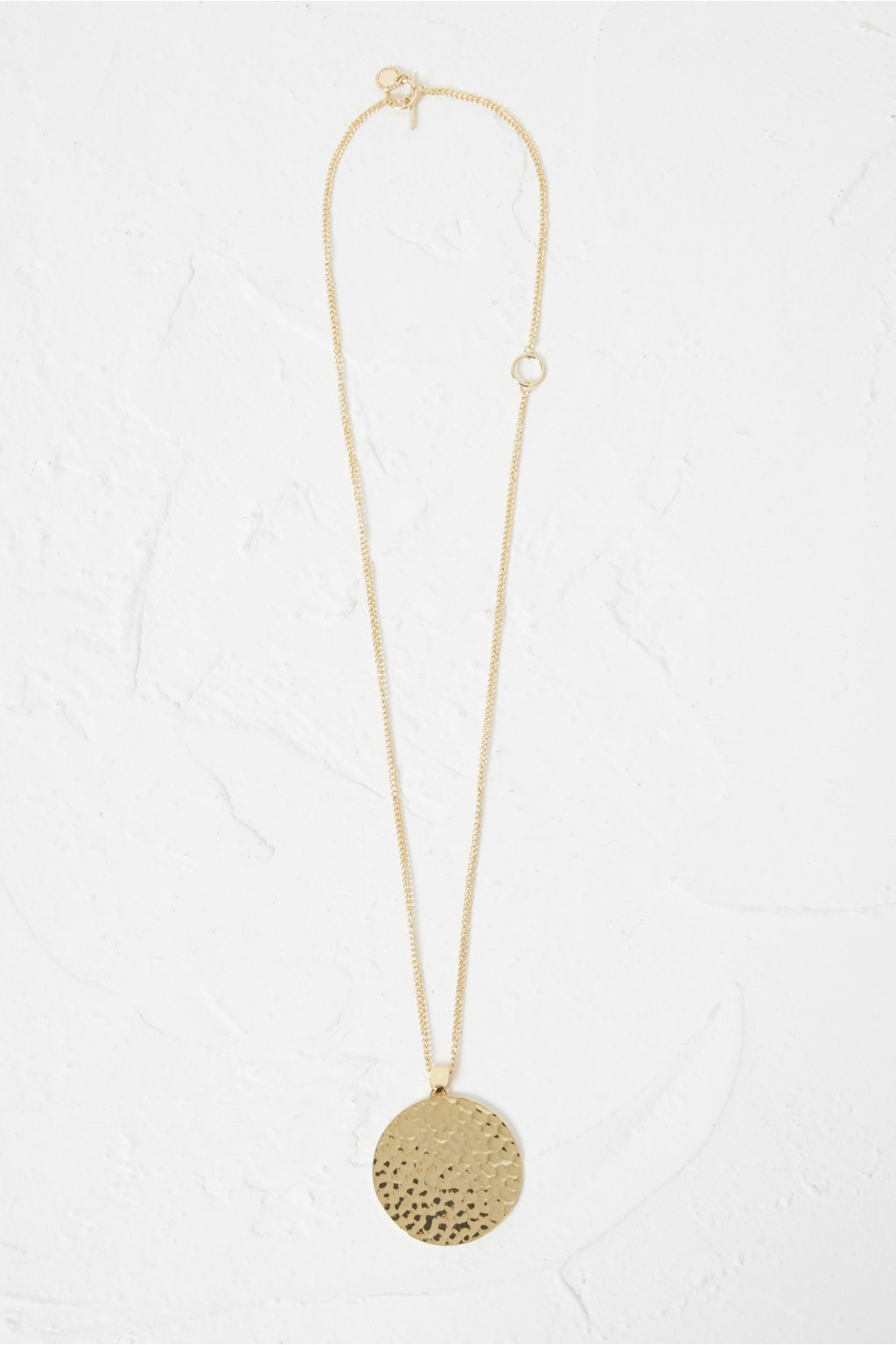 dc8ae33343a8c8 Hammered Disc Pendant Necklace | Collections | French Connection